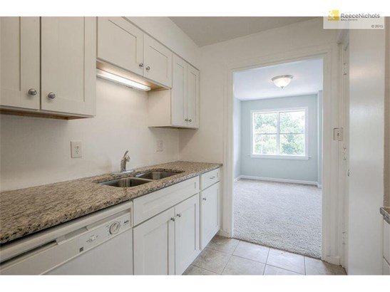 The kitchen boasts granite counters, tile floor, pantry and more. (photo 4)