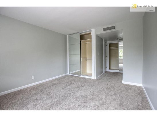 The master bedroom has new carpet and floor to ceiling mirrored doors. (photo 5)
