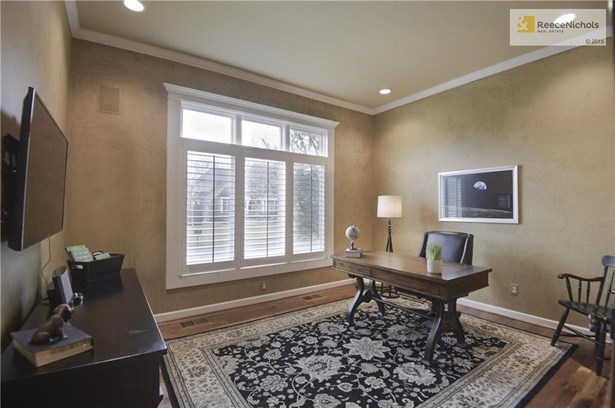 Main floor Office includes plantation shutters and hardwood flooring. (photo 4)