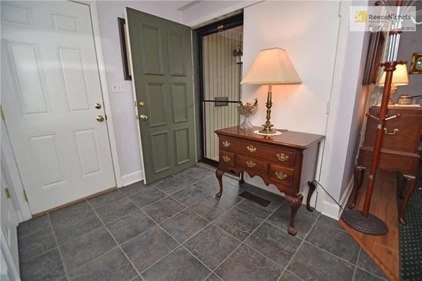 Double front door at entry and updated interior doors thru out. Tiled floor, all white trim and a coat closet (photo 3)