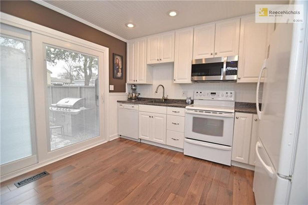 Remodeled kitchen with hardwoods and blinds-in-glass slider (photo 4)