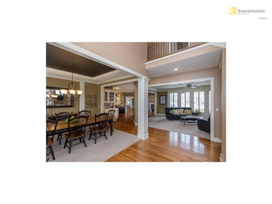 Gleaming hardwoods throughout front entry, kitchen, hearth room, and back hallway. (photo 3)