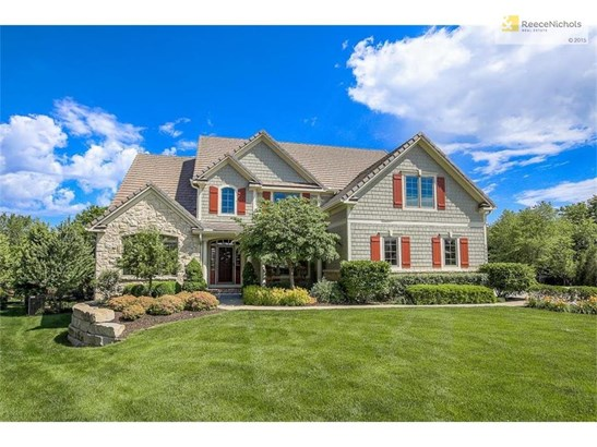 Beautiful curb appeal with lush landscape around perimeter of the property! (photo 1)