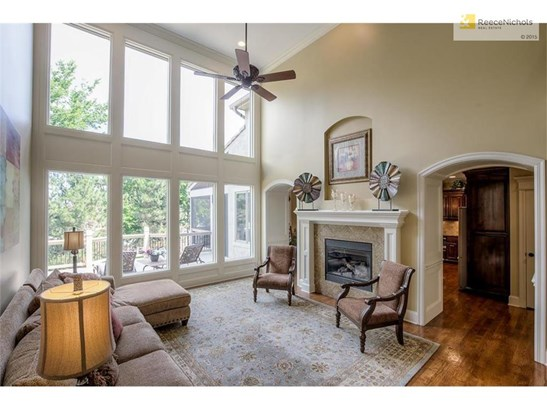 Gleaming hardwood floors, designer paint colors, floor to ceiling windows and handsome fireplace (photo 3)
