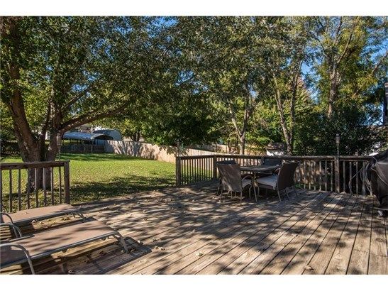 Wonderful large deck opens to a huge deck.  Entertain here in the shade. (photo 2)