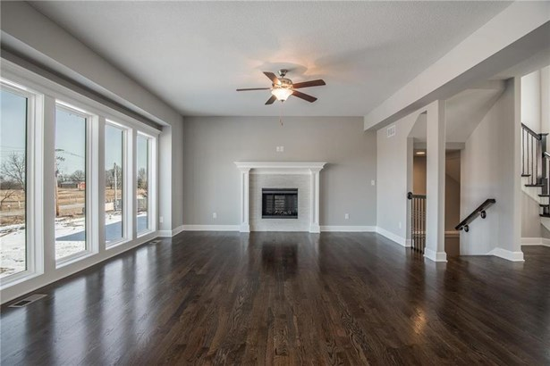 Gorgeous living room with hardwood flooring and custom fireplace.  TV mount over the fireplace. (photo 4)