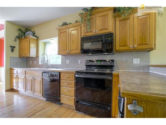 Spacious kitchen with hardwood flooring and all appliances stay, including an ice maker. (photo 5)