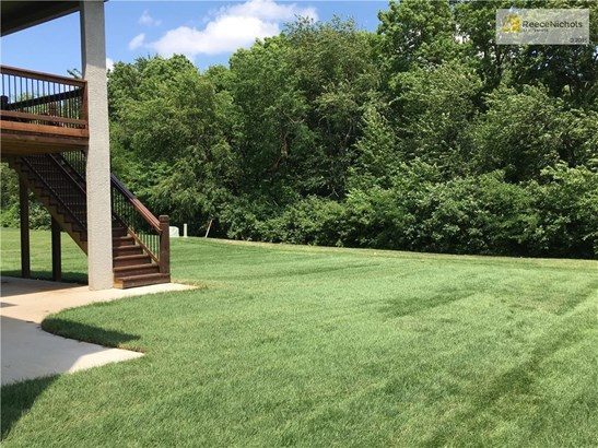 Private back yard with covered deck and covered patio. Bring your BBQ, fire pit and a Play set for the kids and you're set for fun. (photo 4)
