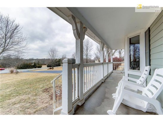 Enjoy coffee on the front porch overlooking the beautiful countryside. (photo 4)
