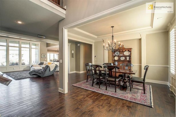 Large formal dining room with gleaming hardwoods throughout most of the first level. (photo 2)