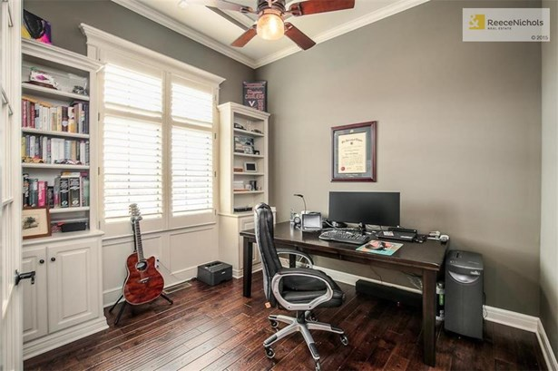 Private office with French doors, built-ins and hardwood floors. (photo 3)