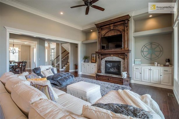 Great room with fireplace, built-ins and with lots of details and character. (photo 4)