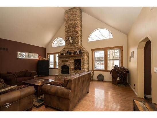 Hardwood floors, beautiful rock fireplace that's wood burning.  Comes with a blower too. (photo 5)