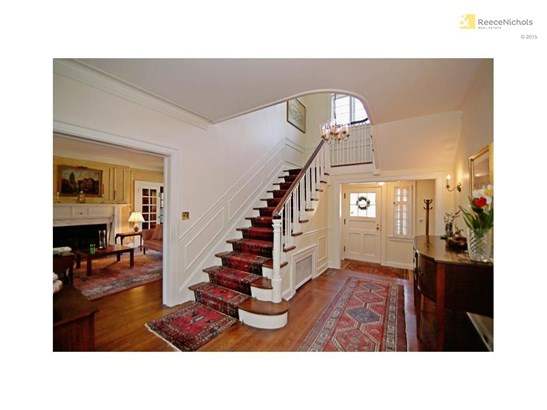 Lovely grand staircase and large inviting formal entry. (photo 2)