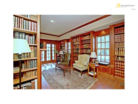 Custom made library with original tile floors. A great space to escape for some quiet time. French doors lead to a large deck and screened porch. (photo 3)