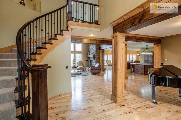 Look at this amazing entry with curved staircase, stunning millwork & trim and gorgeous hardwood flooring throughout! (photo 3)
