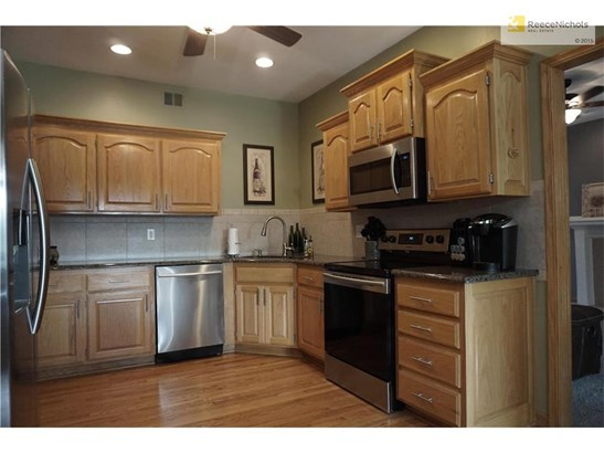 Kitchen with Granite Counter Tops and New Stainless Steel Appliances. (photo 3)