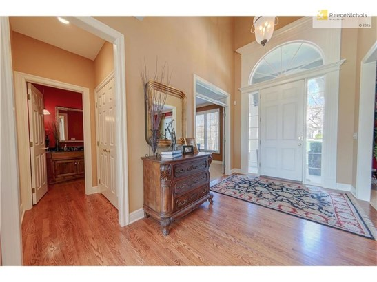 Welcoming & spacious entry with office and powder room (photo 3)