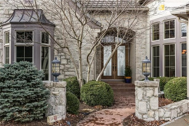 Lovely landscaping, double entry doors, stamped concrete pathway, stone pillars. Bay windows in dining room and in 2nd bedroom on main floor. Pretty entry to a beautiful home on a stellar lot. (photo 1)