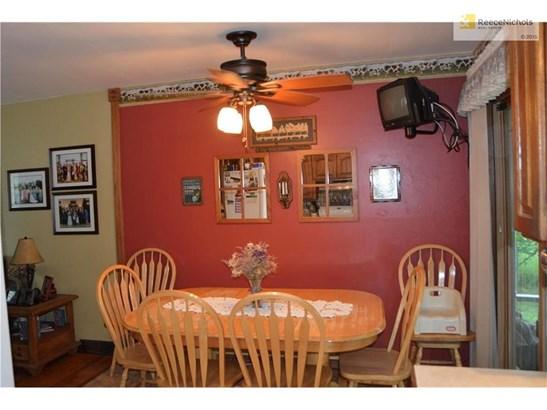 Dining Area opens to Living room with sliding glass doors to three season sun room (photo 5)