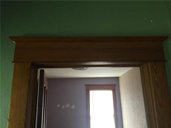 Original trim around a doorway. (photo 3)