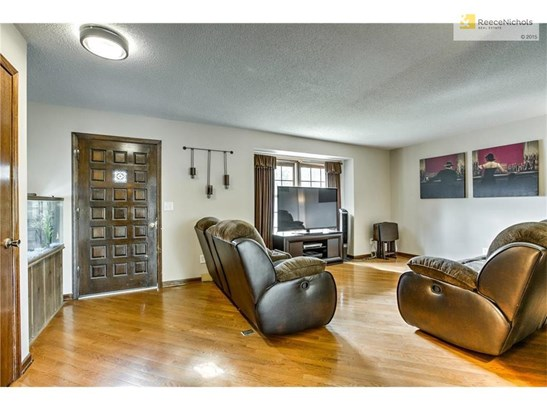 Spacious great room with wood floors. (photo 3)