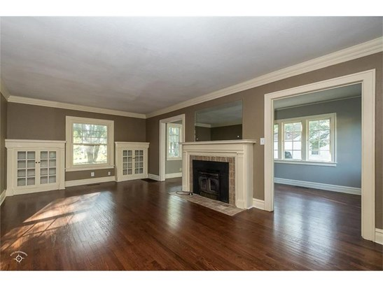 Living room with wood burning fireplace and built-ins! (photo 2)