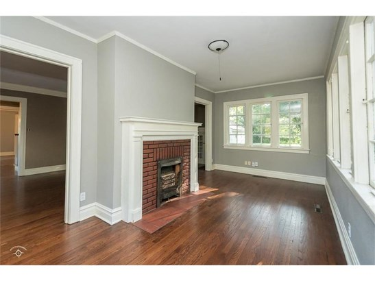 Sun room/extra living area with gas fireplace and tons of natural light. (photo 5)