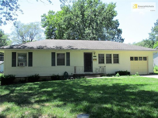 This ranch home has vinyl siding, a 10-year-old roof and plenty of shade in the front yard. (photo 1)