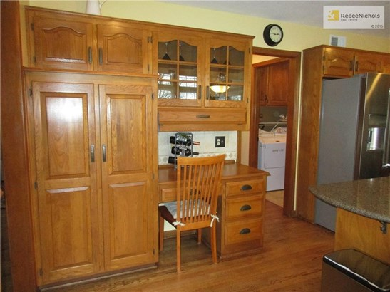 Kitchen Pantry & Glass-fronted Cabinets; View to Laundry Room (photo 5)