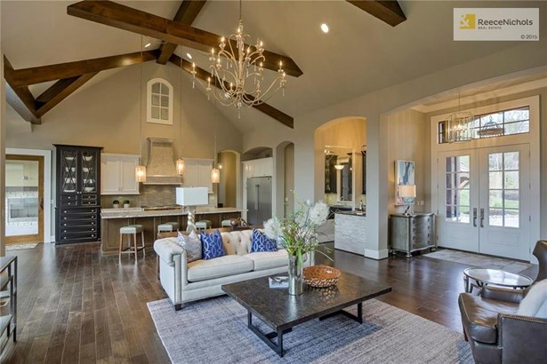Double door entry opens up to this stunning great room.  You will love the high, beamed ceiling and wall of windows overlooking the treed lot. (photo 3)