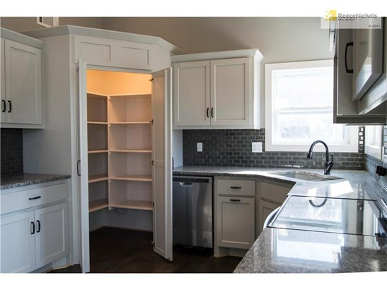 Large and lighted walk-in pantry for all of your culinary storage needs. (photo 4)
