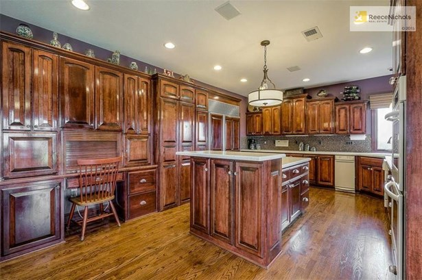 Custom cabinets, walk-in pantry, subzero fridge are just a few of the highlights in this kitchen! (photo 5)