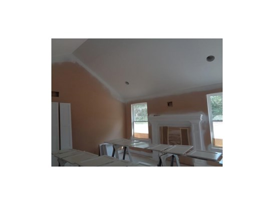 View from the kitchen looking into the living room.  Vaulted ceiling and 2 spacious bedrooms (photo 5)