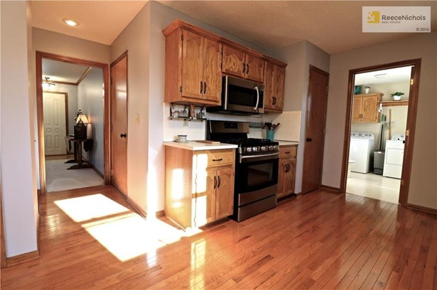 Pantry! Laundry and 1/2 bath located on main off kitchen. Stainless gas range! (photo 5)