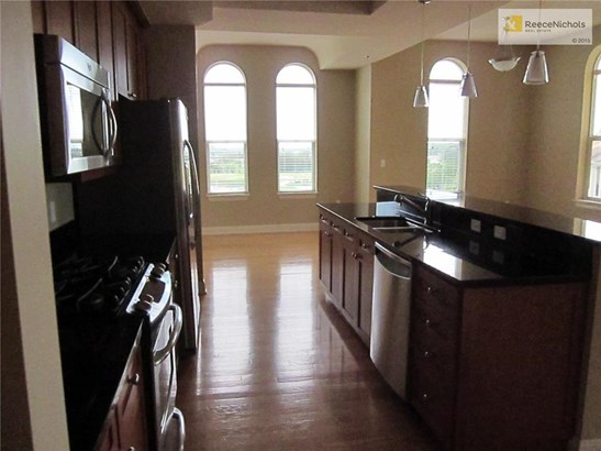 Kitchen looking towards dining room and west windows. (photo 2)