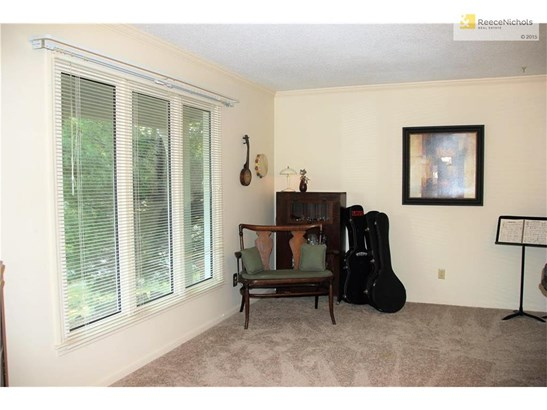 Sitting room, piano room or just a reading room right off front entry, neutral dcor  in every sense of way (photo 2)