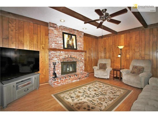 Cozy family space with a true brick fireplace, laminate flooring and large enough for a gathering of TV and fans! The patio is just steps away for the overflow! (photo 5)