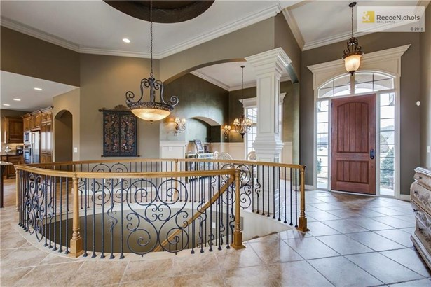 Gorgeous entry opens to expansive living space and beautiful staircase. (photo 3)