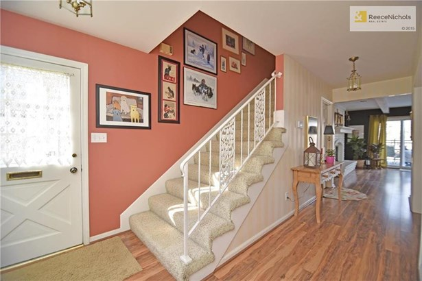 Welcoming entry! You'll appreciate the wide hallways and staircase in this home (photo 2)