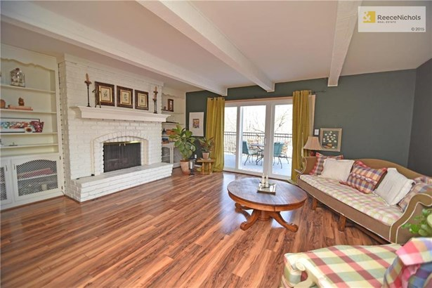 You'll enjoy the wide-plank hardwoods, newer windows and the natural light streaming thru the 3-pane sliding door (photo 3)