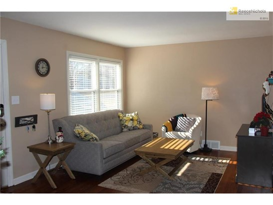 Living room is updated and ready for you.  Beautiful wood floors run throughout this home. (photo 3)