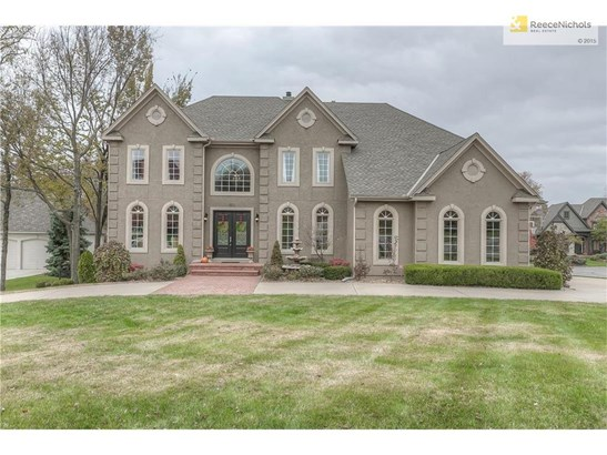 Wonderful curb-appeal with brick porch, circle drive, and side-entry garage (photo 2)