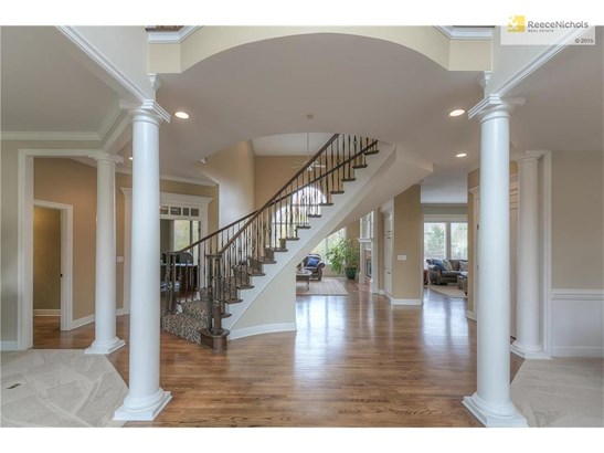 Dramatic 2-Story Foyer with Wood Floors and Curved Staircase (photo 3)