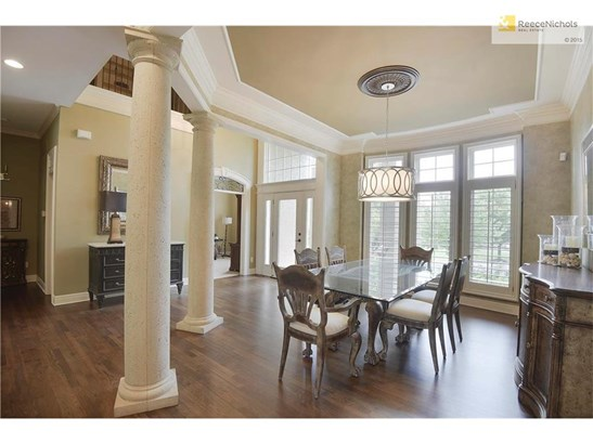 Grand two story entry with updated light fixture. (photo 2)