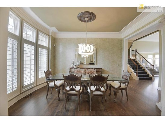 Formal dining room boasts stately columns and new designer chandelier. (photo 3)