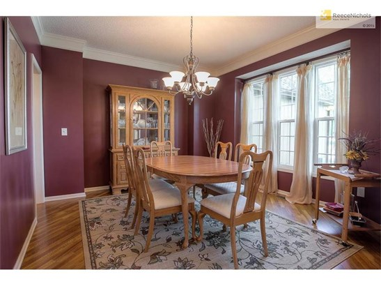 FORMAL DINNING ROOM WITH HARDWOOD FLOORS ADDED (photo 5)