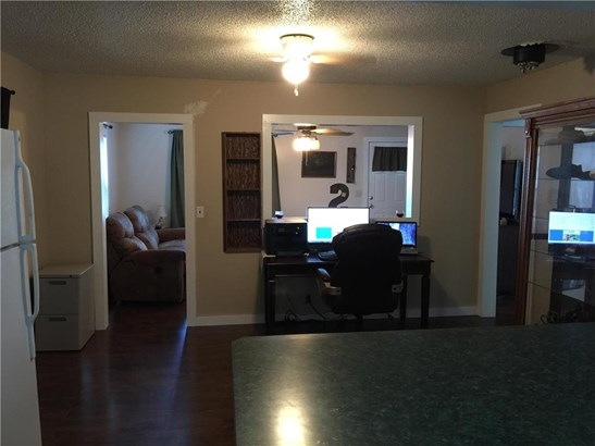 Taken from the kitchen looking to the dining room and through to the living room. (photo 5)