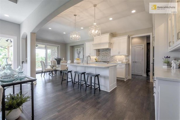 You'll enjoy relaxing and entertaining in the finished lower level with walk-up wet bar and game room! (photo 3)