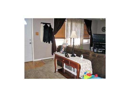 Front Door opens up to Living Room (photo 4)